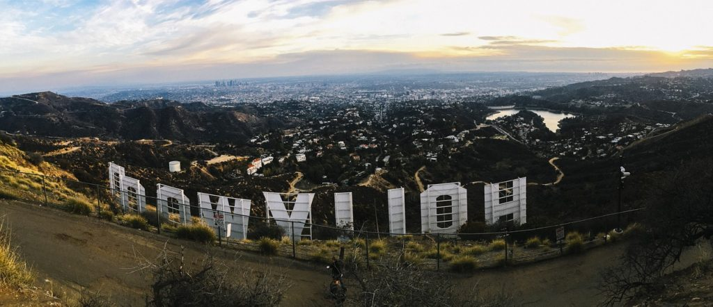 hollywood sign from behind with los angeles skyline